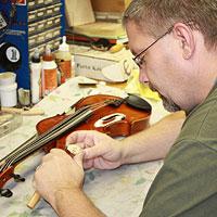 Man repairing a violin.