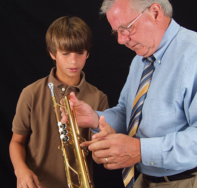 Music instructor with trumpet student