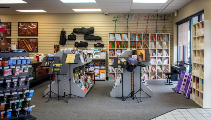 A display of printed music and music stands.