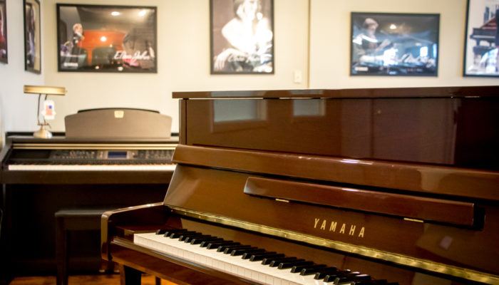 Yamaha P22 upright piano in Walnut finish.