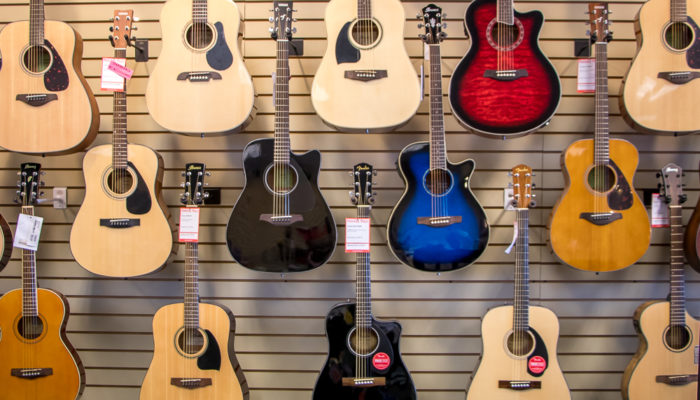 Wall display of acoustic guitars.