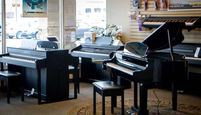 Several Yamaha Clavinova digital pianos.