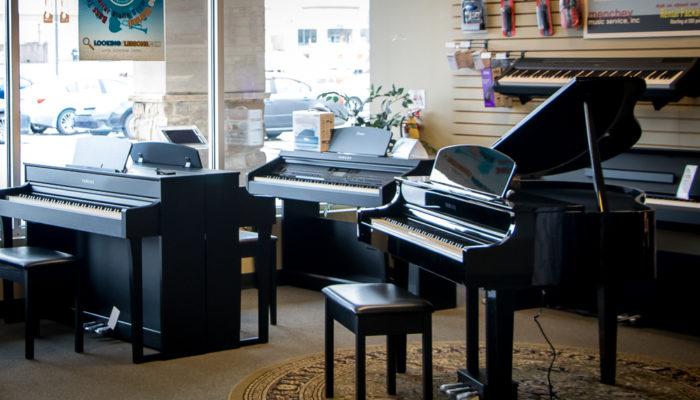 Several Yamaha Clavinova digital pianos.