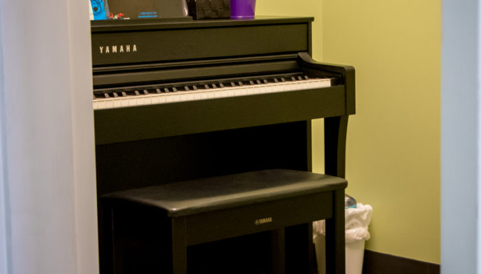 Music lesson studio with Yamaha piano.