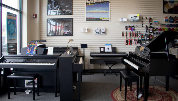 Yamaha Clavinova digital pianos with posters.