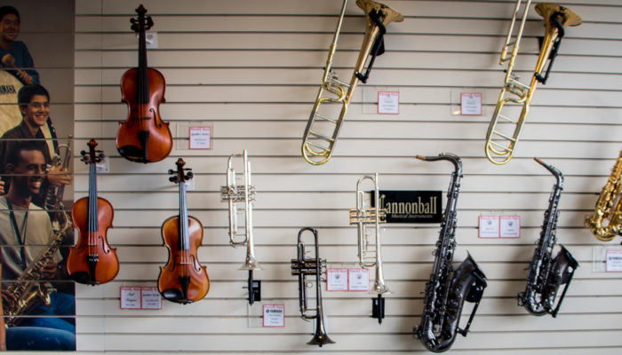 Wall display of band and orchestra instruments.