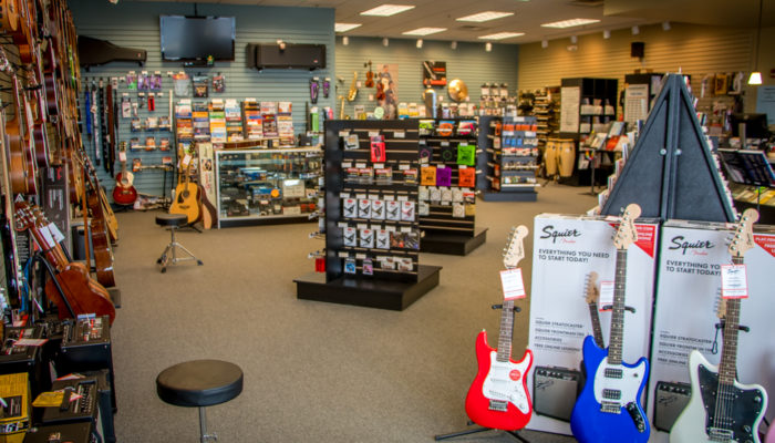 Displays of electric guitars and guitar accessories such as picks.