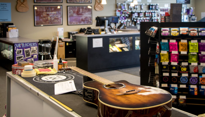 An acoustic guitar being repaired.