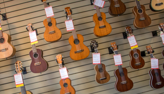 Ukuleles on wall display.