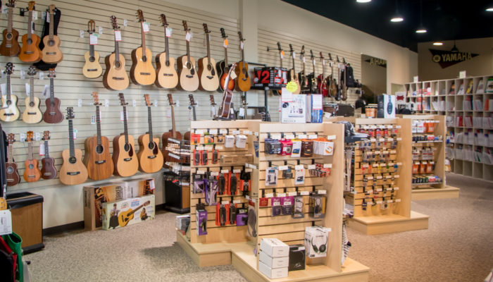 Acoustic guitars with a selcection musical accessories in front of them.