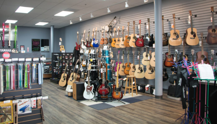 Display of acoustic and electric guitars.