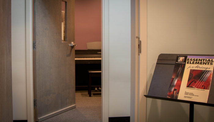 Private lesson studio with piano.