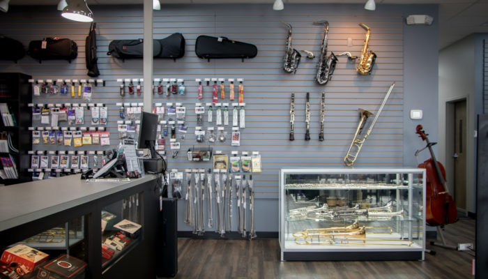 Counter with display of band instruments and band accessories.