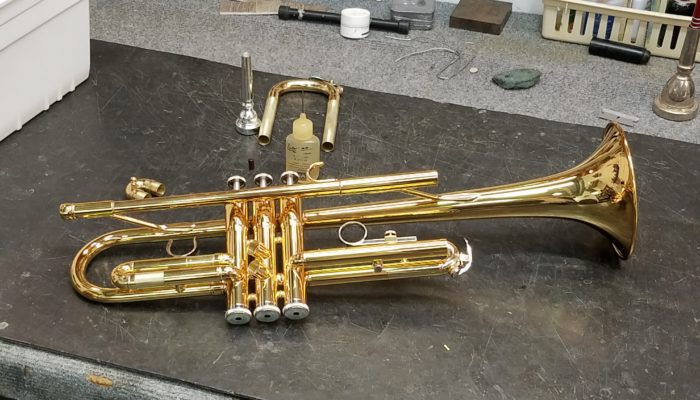 Brass trumpet with it's slides removed for repair and cleaning.
