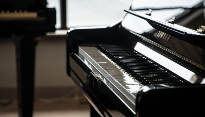 Black Yamaha grand piano.