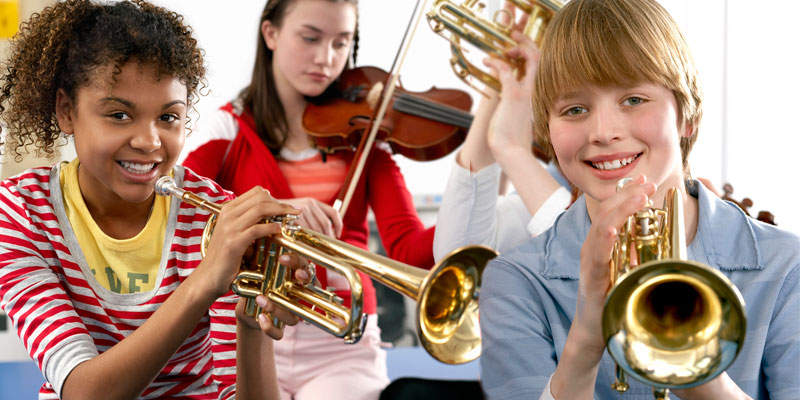 school band students playing instruments
