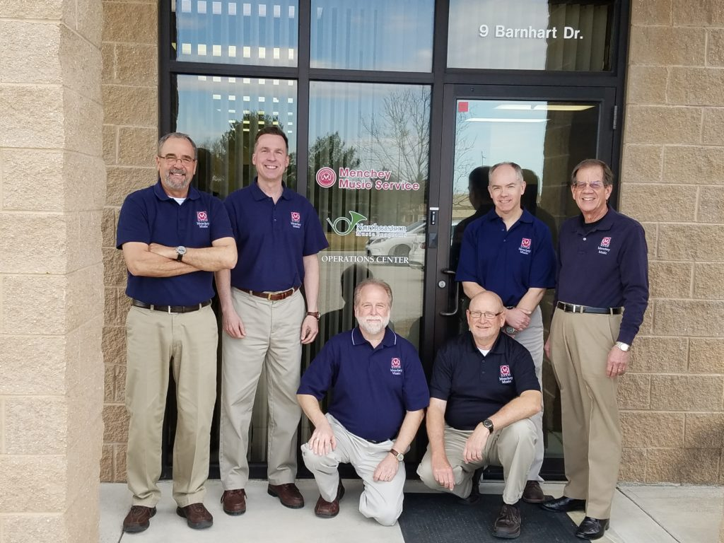Six Menchey employees in front of our Operations Center.