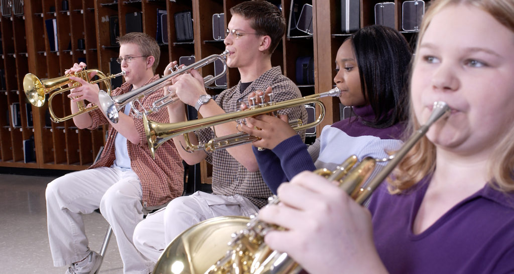 4 musicians playing intermediate brass band instruments.