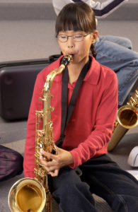girl playing saxophone