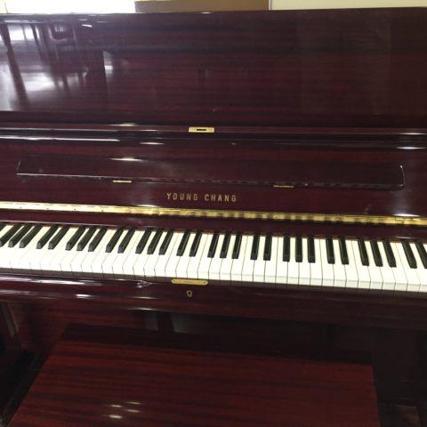 Young Chang model PE-121 polished mahogany upright piano.