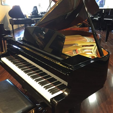 "Yamaha model GH1 5'3"" grand piano finished in polished ebony includes matching bench and one free delivery."