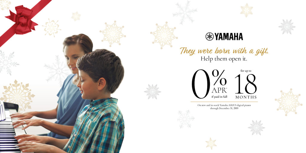 Mother sitting with her son at piano. Yamaha 0% financing for up to 18 months.
