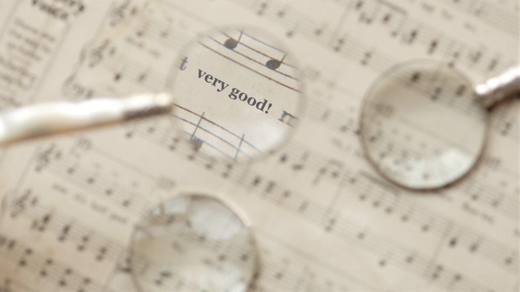 Close up of music notes with magnifying glass