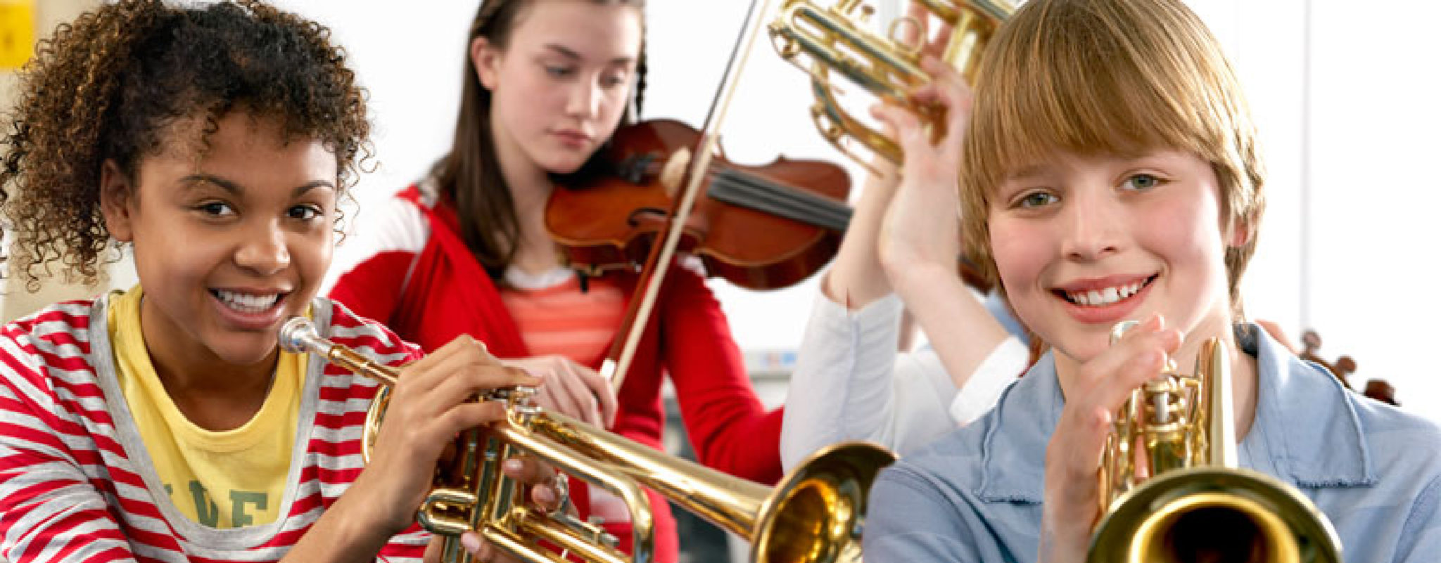 School band students playing trumpets and violins.