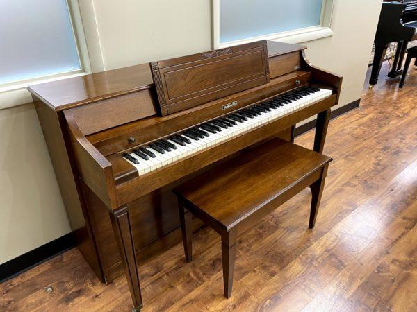 """Baldwin """"Howard"""" model walnut 36″ upright piano w/matching bench ($999)"""