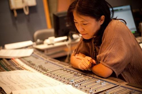 Yoko Shimomura composing at her studio.